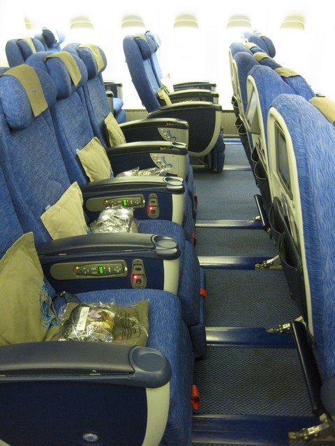 1ccee1bbaf01 I passed the two rows of club world and was soon in the World Traveller  Plus Cabin. Headphones